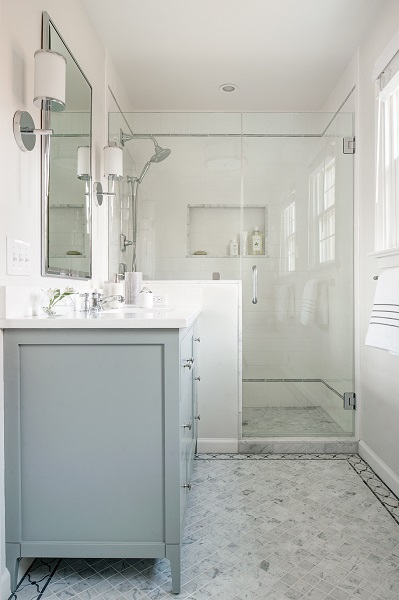 Wall sconces in hall bath by Philadelphia interior designer Glenna Stone